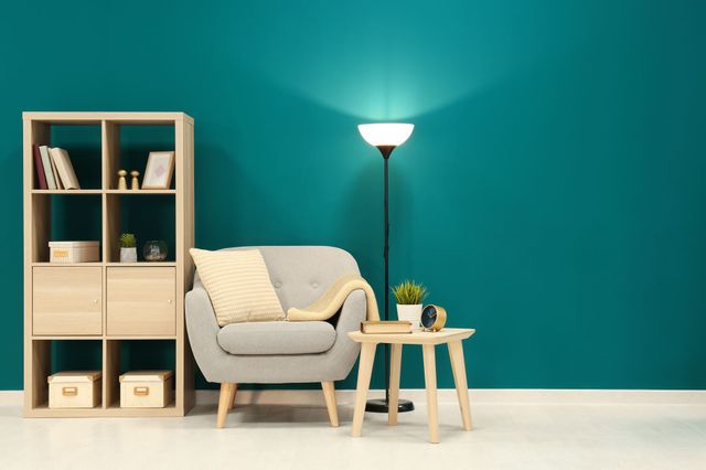 Green background living room with isolated lamp