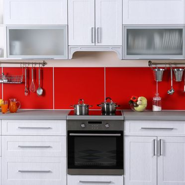 modern kitchen with red splash back